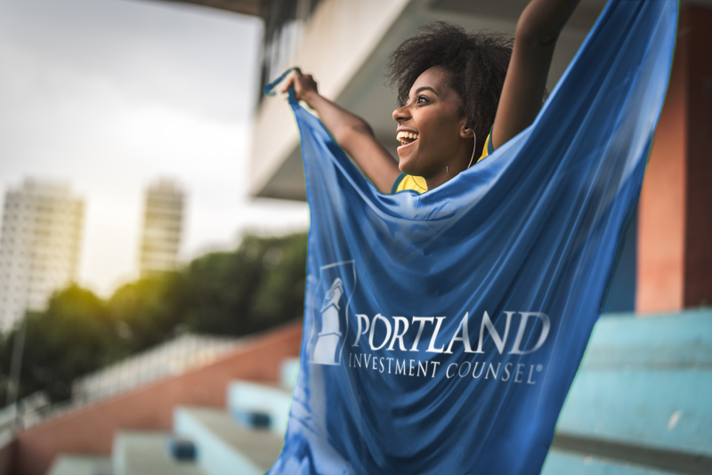 Girl with Portland Investment Counsel flag